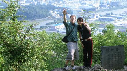 Author and friend above North Korean city of Hyesan [the primary commercial border crossing is just above our heads]