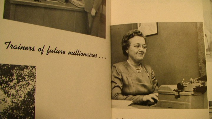 """Maude Linquist, head of UMD history department, makes plans for her summer venture to the West.""  University of Minnesota, Duluth, 1955 Yearbook."
