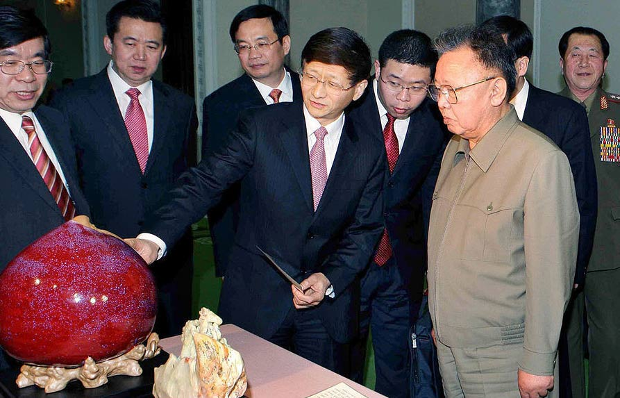 Liu Hongcai, Chinese Ambassador in Pyongyang, extreme left, looks on while PRC Public Security Minister Meng Jianzhu presents a gift to a nonplussed Kim Jong Il two days before his 69th birthday -- courtesy Huanqiu Shibao