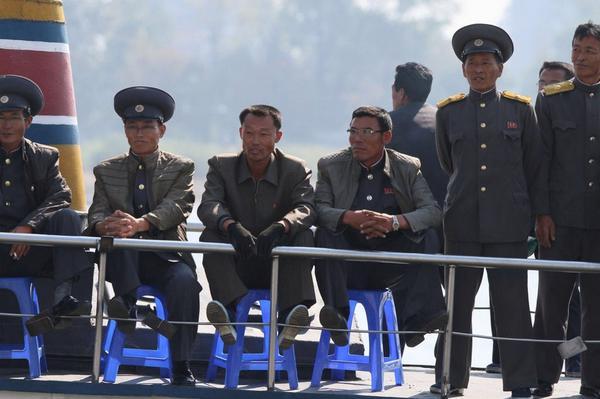 North Koreans off the shores of Dandong, PRC, on 6 October 2014. Photo via Xinhua/Huanqiu Shibao.