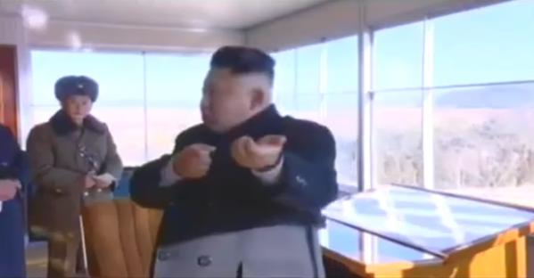 KJU machine gun hands