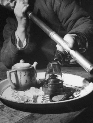 Customer Smoking Opium at an Opium Den by George Lacks